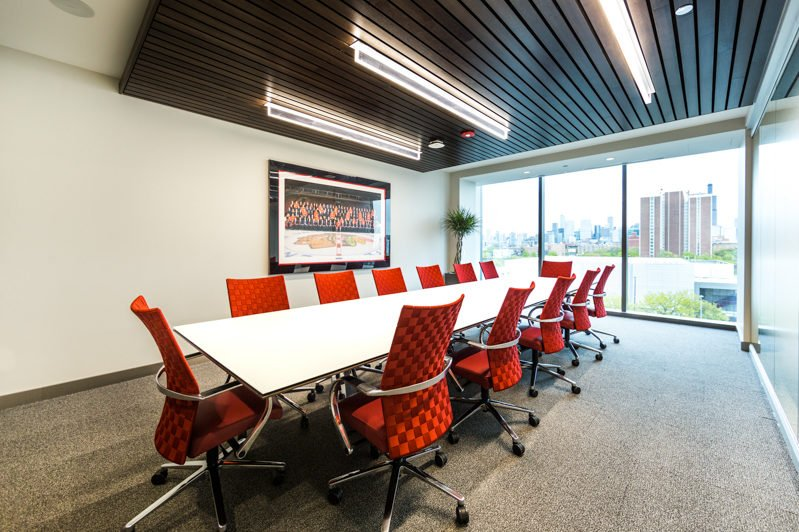 An empty meeting room with red chairs and a picture of the Chicago bulls United Center as photographed for a digital marketing campaign by Loudbyte