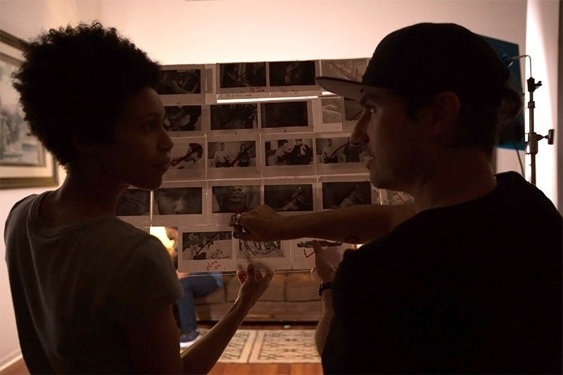 Music Video Director and DP stare at storyboard